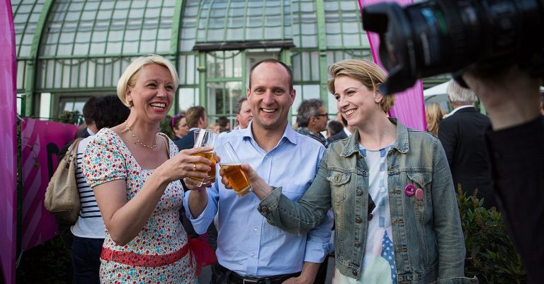 """<p>Matthias Strolz, Angelika Mlinar and Beate Meinl-Reisinger am 16. Mai 2013 / By Nicole Heiling (Flickr: Es geht auch anders! Das FEST!) [<a href=""""https://creativecommons.org/licenses/by-sa/2.0"""">CC BY-SA 2.0</a>], <a href=""""https://commons.wikimedia.org/wiki/File:Mlinar,_Strolz_and_Meinl-Reisinger_at_the_NEOS_FEST_Vienna_2013-05.jpg"""">via Wikimedia Commons</a></p>"""